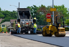Road workers with asphalt Stock Image