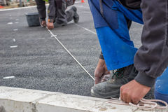 Road workers chalking Royalty Free Stock Photo