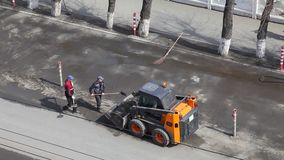 Road workers clean the street. Cleaning the streets of garbage. View from above stock video footage