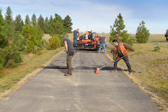 Road workers fixing driveway Stock Image