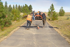 Road workers fixing driveway Stock Photo