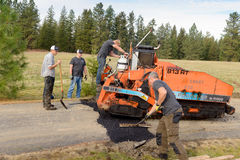 Road workers fixing driveway Stock Photos