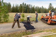 Road workers fixing driveway Royalty Free Stock Photography