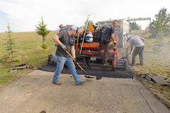 Road workers fixing driveway Stock Images