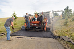 Road workers fixing driveway Stock Photography