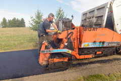 Road workers fixing driveway Royalty Free Stock Image