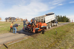 Road workers fixing driveway Royalty Free Stock Photo