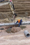 Road workers installing storm drain system 2 Royalty Free Stock Image