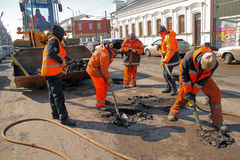 Road workers mend road Royalty Free Stock Images