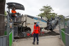 Road workers with a modern machine in Paris, France stock photo