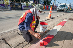 Road workers paint borders Stock Photo