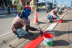 Road workers paint borders royalty free stock images