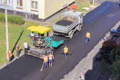 Road workers producing related work. Stock Photography