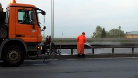 .Road workers wash the split bar at Pulkovo highway in St. Petersburg.Russia. stock video