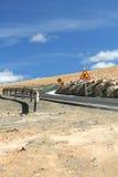 Road Works. Repair asphalt road against a blue sky Stock Images