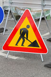 Road works. Triangular traffic sign at construction site Stock Photos