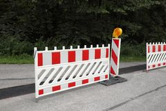 Road works. With barricade on the street royalty free stock photography