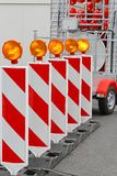 Road works barrier. Road barrier with amber beacon flashing lights Royalty Free Stock Image