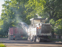 Road works in the city. Working on special equipment cut off the old asphalt on a Sunny summer day. Road works in the city. Working on special equipment cut off Stock Images