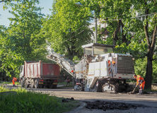 Road works in the city. Working on special equipment cut off the old asphalt on a Sunny summer day. Saint-Petersburg. Russia. Summ. Road works in the city Stock Images