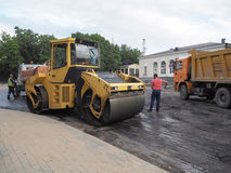Road works in the city. Working on special equipment cut off the old asphalt on a Sunny summer day. Saint-Petersburg. Russia. Summ. Road works in the city Royalty Free Stock Photography