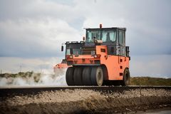 Road works in the city. Working on special equipment. Royalty Free Stock Images