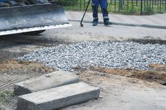 Road works. On closing holes in the road in summer royalty free stock photography