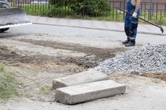 Road works. On closing holes in the road in summer stock photo