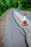 Road works on cracked tarmac from subsidence Royalty Free Stock Images
