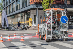 Road works. Equipment painting road marks royalty free stock image