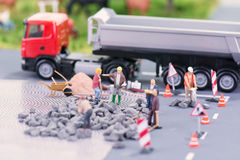 Road works with miniature figurines Stock Photo