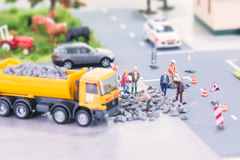 Road works with miniature workers Royalty Free Stock Photography