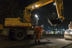 Road works, replacing asphalt pavement at night in Rotterdam, Th Royalty Free Stock Photo