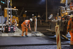 Road works, replacing asphalt pavement at night in Rotterdam, Th Royalty Free Stock Image