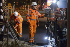 Road works, replacing asphalt pavement at night in Rotterdam, Th Royalty Free Stock Images