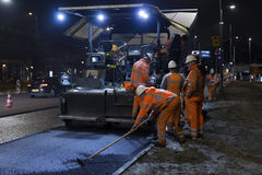 Road works, replacing asphalt pavement at night in Rotterdam, Th Stock Image