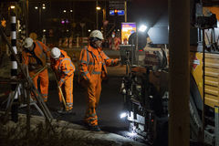 Road works, replacing asphalt pavement at night in Rotterdam, Th Stock Photo