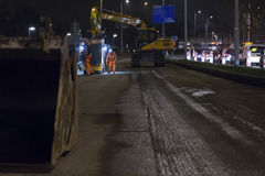 Road works, replacing asphalt pavement at night in Rotterdam, Th Stock Photos