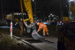 Road works, replacing asphalt pavement at night in Rotterdam, Th Royalty Free Stock Photos