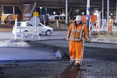 Road works, replacing asphalt pavement at night in Rotterdam, Th Stock Images