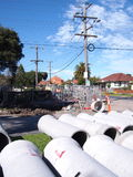 Road works in a residential area with big concrete pipes Royalty Free Stock Photo