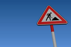 Road Works Road Sign. At low angle on blue background Stock Photo