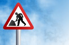 Road works sign. Warning road works in progress sign against a sky background Royalty Free Stock Photos