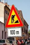 Road works sign for construction works in city street. Road under construction traffic sign. Traffic, warning sign road repairing. Outdoor street sign. Red Royalty Free Stock Images