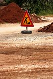 Road works sign for construction works, road, pavement construction. Traffic, warning sign road repairing, road maintenance. Red, black, yellow triangle road Stock Photos