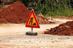 Road works sign for construction works, road, pavement construction. Traffic, warning sign road repairing, road maintenance. Red, black, yellow triangle road Stock Image