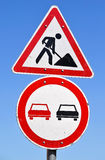 Road works sign. Road works and no over taking traffic signs Stock Photos