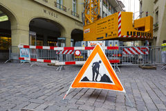 Road-works sign is placed on the road in Bern Stock Images