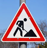 Road works sign at the road crossing Royalty Free Stock Photography