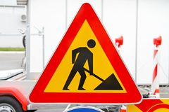 Road works sign. Road works triangular traffic sign at construction site Royalty Free Stock Photography